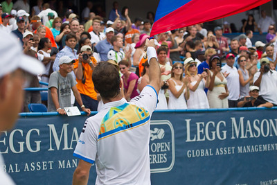 Radek Stepanek, of The Czech Republic, celebrates a victory by waving his national flag at the successful conclusion of his championship tennis match against Gael Monfils, of France, at the Legg Mason Tennis Classic, Sunday, Aug. 7, 2011, in Washington DC. The unseeded Stepanek upset the top seed Monfils in the finals in straight sets 6-4 6-4. The match was played at the William H.G. Fitzgerald Tennis Center in Rock Creek Park on hard court. Stepanek earned a check for $264,000 for his fifth career title. Stepanek at 32 became the oldest winner of the ATP Washington Classic since Jimmy Connors in1988. (Photo by Jeff Malet)