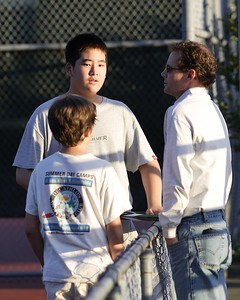 Coach Brad gives tips to Richard and Collin