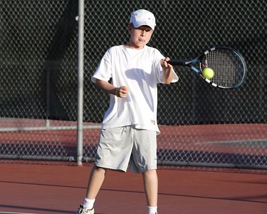 Anthony concentrates on his forehand