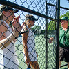 Nashoba head coach Steve Winer pep talks Keegan Castles and Cayla Murphy during the division 1 girls' tennis state championship against Wellesley on Wednesday afternoon. SENTINEL & ENTERPRISE / Ashley Green