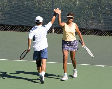 Peter and Clover hi-five after a good point
