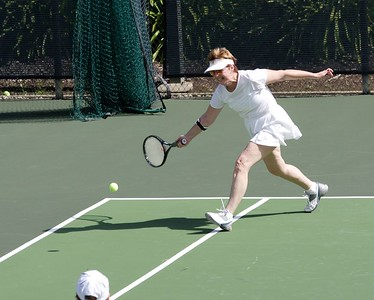 Mary learned her running forehand from her pal Pete