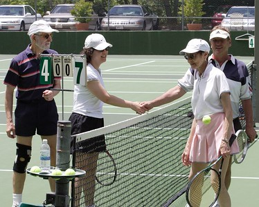 Ken, Shiao-Ping , Tom, and Pauline shake hands at the end of the decisive match.