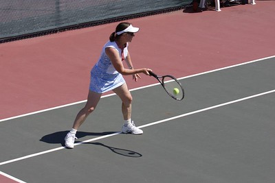 Jeanette pops an inside-out forehand