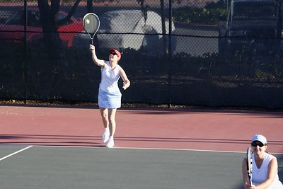 Jeanette delivers a serve...