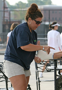 Volunteer from Floyd Athletic Trainer Dawn Corbin from Rome GA tapes an ankle