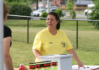 Volunteer Julie Lott from Rockmart GA, plays with the Rome Tennis Club