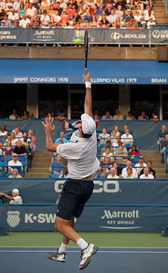 "the tallest player in tennis, 6'10"" Ivo Karlović stretches for the ball in a quarterfinals match against Andy Roddick (Aug 7, 2009)"
