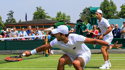 Pakistani tennis player Aisam-ul-Haq Qureshi and Dutch player Jean-Julien Rojer, on court in men's doubles match, All England Lawn Tennis Club, Wimbledon
