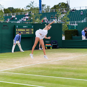 Amanda Anisimova, American tennis player, serves at the Wimbledon Championships 2016