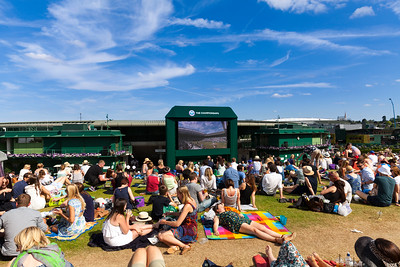 Wimbledon crowds watch from Henman Hill, also now known as Murray Mount, on a beautiful sunny day