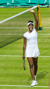 American tennis player Venus Williams waves at the crowds