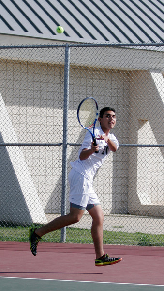 Woodlake Tiger Tennis No. 1 seed Bladamir Sanchez hits a backhand against Lindsay on Thursday, March 20th.