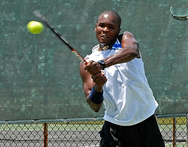 Robbye Poole returns the ball Saturday afternoon during the Southern Adult Hardcourt championships at Laurel Park in Marietta.