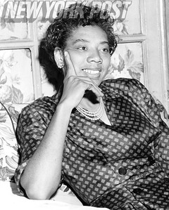 Wimbledon winner, Althea Gibson, conducts an interview from her home in Harlem. 1957
