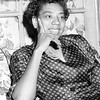 Wimbledon winner, Althea Gibson, conducts an interview from her home in Harlem.