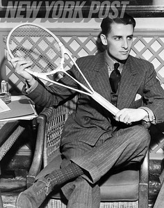 English tennis star Bunny Austin examines a new type of tennis racquet as a passenger on the RMS Aquitania. 1939