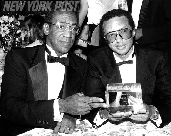 Bill Cosby presents Award to Arthur Ashe at Gala. 1988