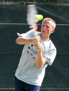 Jamie Cox returns the ball Friday evening during the Southern Adult Hardcourt Championships at Laurel Park in Marietta.