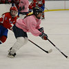 RYAN HUTTON/ Staff photo.<br /> Andover's Brenna Keefe (11) leads the puck away from Tewksbury/Methuen's Kelly Golini (3) during Thursday's game. Tewksbury/Methuen won 3-1.