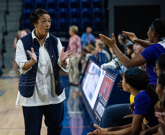Texas College women's basketball coach Elissia Burwell applauds during their game at the University of Texas at Tyler against the Patriots on Monday, Nov. 11, 2019.  (Sarah A. Miller/Tyler Morning Telegraph)