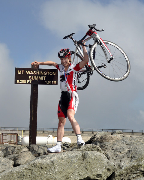 Sue Schlatter, 46, of Ottawa, Ontario, Canada, raises her bike in celebration of her women's division victory at the 2009 Mt. Washington Auto Road Bicycle Hillclimb. Ms. Schlatter powered her way up the 7.6 mile course in a time of 1:07:43, a new course record for the 45-49 age group.