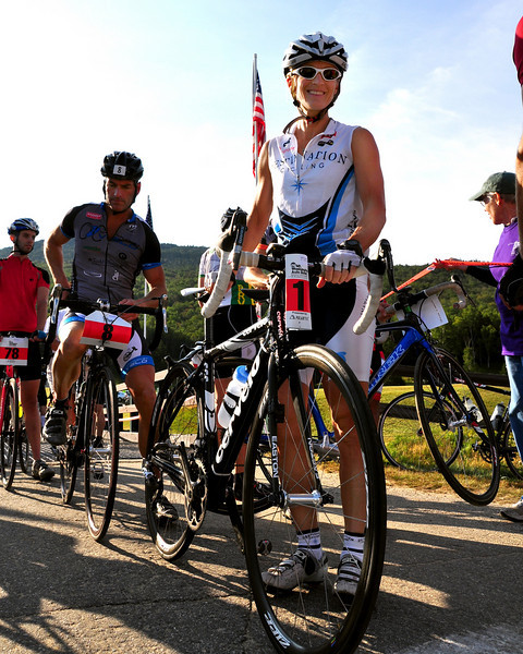 #1, Marti Shea, formerly of Manchester, NH, now of Marblehead, MA, and #8, Todd Burns, of Nantucket, MA, make their way to the starting line of The 38th Annual Mt. Washington Auto Road Bicycle Hillclimb, which was held on August 21st, 2010, in Gorham, New Hampshire. 600 cyclists raced up the grueling 7.6 mile Auto Road course, to the 6,288' summit of Mt. Washington, the highest peak in the Northeastern United States. Ms. Shea went on to win the women's division, with a time of 1:05:42.