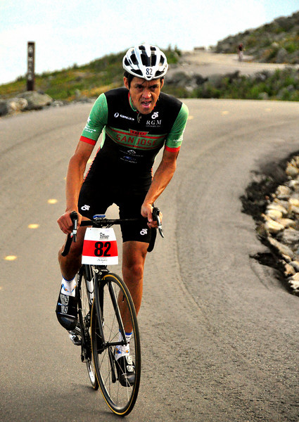 "Nico Toutenhoofd, of Boulder, Colorado, pushes himself hard past the 6 mile marker, during The 38th Annual Mt. Washington Auto Road Bicycle Hillclimb, which was held on August 21st, 2010, in Gorham, New Hampshire. 600 cyclists raced up the grueling 7.6 mile Auto Road course, to the 6,288' summit of Mt. Washington, the highest peak in the Northeastern United States. Mr Toutenhoofd went on to win the race with a time of 57.26, over 2nd place rider David ""Tinker"" Juarez, of Whittier, CA."