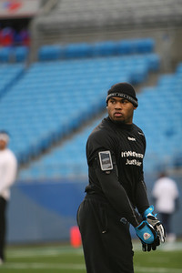 Panthers WR Steve Smith warms up along the sidelines.