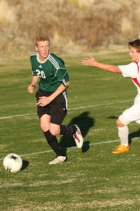 Soph Marcus Christensen looks to cross in front of the Marywood Palm Valley goal