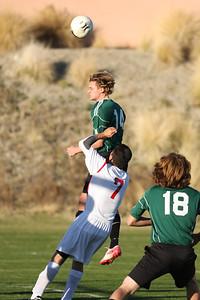 Sr Robbie Moyneur (captain) heads the ball while Leo Korf (18) reacts.