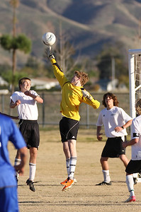 Soph. Nate Moody (keeper), Chris Bonney (left), Leo Korf (soph) and Robbie Moyneur (Sr., one of three captains), far right