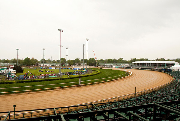 Race fans pick out their spots in the Infield at Churchill Downs during the 139th Kentucky Derby in Louisville on Saturday morning. Staff photo by Christopher Fryer