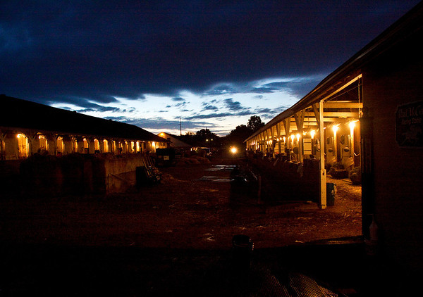 The sun rises above the horse barns at Churchill Downs during morning training before the 139th Kentucky Derby in Louisville on Saturday. Staff photo by Christopher Fryer