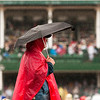 Bob Lentz, of Chicago, stands under an umbrella in the Infield of Churchill Downs during the 139th Kentucky Derby in Louisville on Saturday afternoon. Staff photo by Christopher Fryer