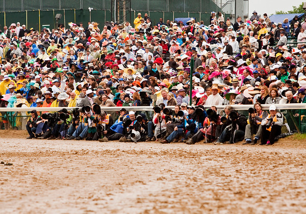 Race fans and photographers wait for the start of the 139th Kentucky Derby at Churchill Downs in Louisville on Saturday evening. Staff photo by Christopher Fryer