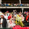 Race goers wait for the start of the 139th Kentucky Derby at Churchill Downs in Louisville on Saturday evening. Staff photo by Christopher Fryer