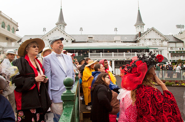 Race goers watch the first race of the day on monitors above the Paddock at Churchill Downs during the 139th Kentucky Derby in Louisville on Saturday morning. Staff photo by Christopher Fryer