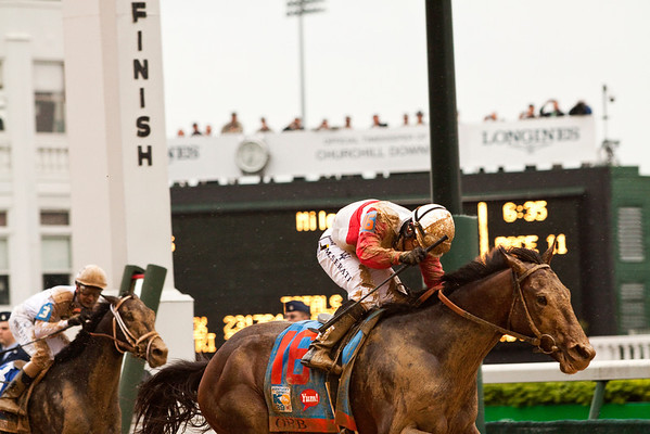 Derby horse Orb crosses the finish line carrying jockey Joel Rosario to win the 139th Kentucky Derby at Churchill Downs in Louisville on Saturday evening. Staff photo by Christopher Fryer