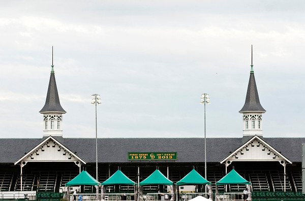 Track lights shine below the twin spires on the Grandstand at Churchill Downs during morning training at the 139th Kentucky Derby in Louisville on Saturday. Staff photo by Christopher Fryer