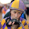 Hall of Fame jockey, Gary Stevens, wipes dirt from his face after finishing the 140th Kentucky Derby at Churchill Downs. Stevens, riding Candy Boy, finished 13th out of 19 total Derby competitors. <br /> Staff photo by Tyler Stewart