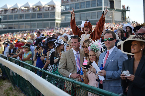 Spectators await the start of the 140th Kentucky Derby Saturday at Churchill Downs.<br /> Staff photo by Tyler Stewart