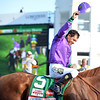 Jockey Victor Espinoza and winning horse, California Chrome, make their way to the Winner's Circle after their victory in the 140th Kentucky Derby at Churchill Downs on Saturday.<br /> Staff photo by Tyler Stewart