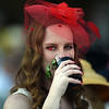 A Kentucky Derby spectator takes a drink of her mint julep before the race.<br /> Staff photo by Tyler Stewart