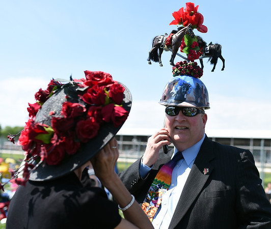 """The Hatman"", Skip Koepnick, sports a unique hat in the infield at Churchill Downs. Koepnick made his way down to his 35th Kentucky Derby from Wyoming, Michigan.<br /> Staff photo by Tyler Stewart"