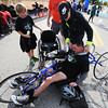 Jennifer Smith puts a medal around the neck of her husband, Brian Smith, after he completed the full marathon on a handcycle Sunday morning, Oct. 13, 2013, at the finish line for the Mother Road Marathon at the Joplin Athletic Complex. Their 10-year-old son Nick Smith looks on at left.<br /> Globe | T. Rob Brown