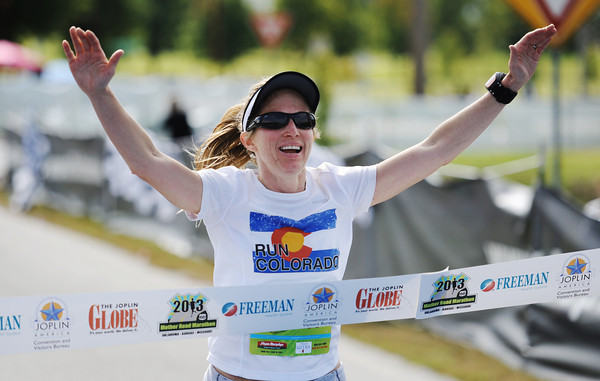 Winner of the women, Erin Goff of Denver, Colo., and formerly of Joplin, crosses the finish line Sunday morning, Oct. 13, 2013, for the Mother Road Marathon at the Joplin Athletic Complex.<br /> Globe | T. Rob Brown