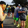 Half-marathon contestants give a silent prayer before starting the race Sunday morning, Oct. 13, 2013, near Baxter Springs, Kan.<br /> Globe | T. Rob Brown