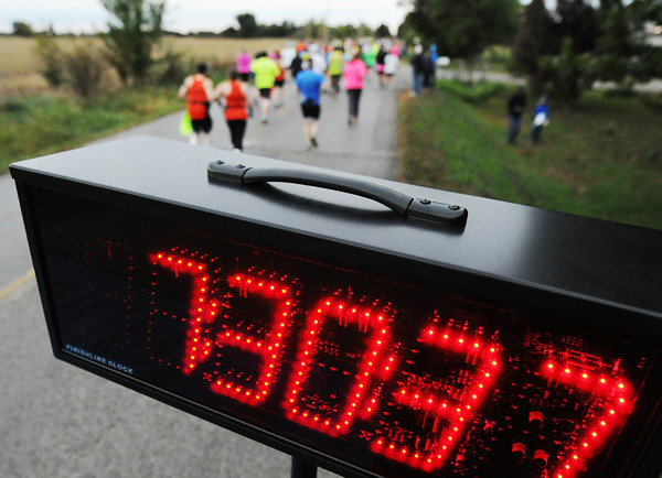 Contestants head down the Mother Road for the half-marathon Sunday morning, Oct. 13, 2013, at the start of that race near Baxter Springs, Kan.<br /> Globe | T. Rob Brown