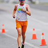 Winner of the men's marathon, Michael Bredehoft, of Clearwater, Kan., has a decisive lead as he runs through downtown Baxter Springs, Kan., Sunday morning, Oct. 13, 2013, during the Mother Road Marathon.<br /> Globe | T. Rob Brown